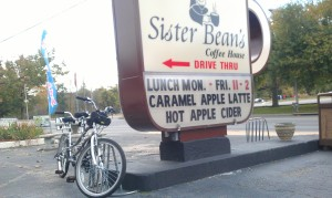 Our Tandem next to the Sister Bean's Coffee shop sign.