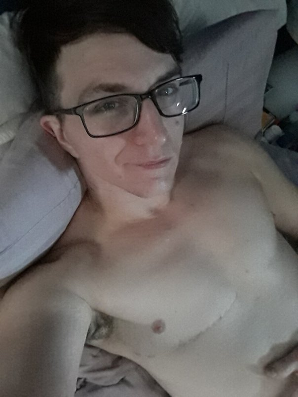 Me, relaxing, shirtless, on some pillows